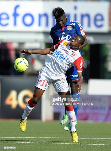 Nancy's Cameroonian forward Paul Alo'o Efoulou fights for the ball Lyon's French defender Samuel Umtiti during their French L1 football match Nancy...