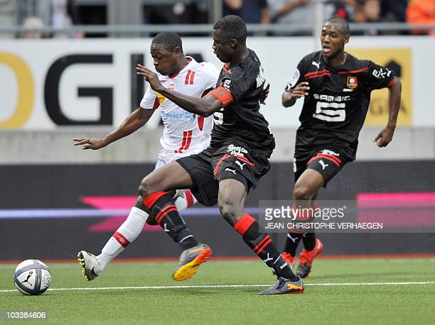 Nancy's Cameroonian forward Paul Alo'o Efoulou fights for the ball with Rennes' Senegalese defender Kader Mangane and Rennes' French defender Kevin...