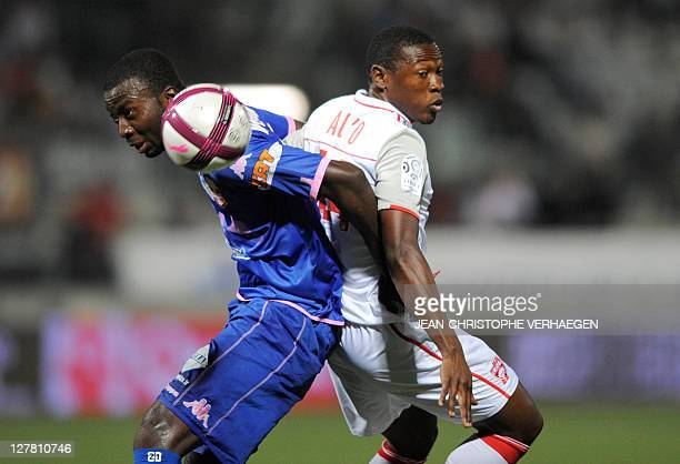 Nancy's Cameroonian forward Paul Alo'o Efoulou fights for the ball with Evian's Congolese defender Cedric Mongongu during their French L1 football...