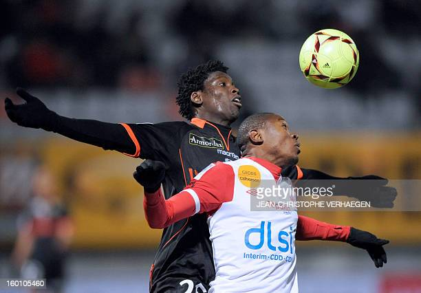 Nancy's Cameroonian forward Paul Alo'o Efoulou fights for the ball with Lorient's Senegalese defender Lamine Gassama during their French L1 football...