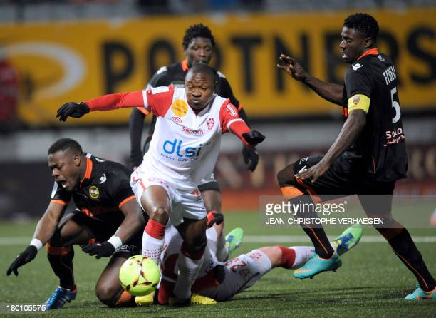 Nancy's Cameroonian forward Paul Alo'o Efoulou fights for the ball with Lorient's Gabonese defender Bruno Ecuele Manga and Lorient's French defender...