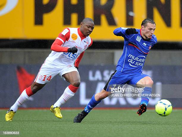 Nancy's Cameroonian forward Paul Alo'o Efoulou fights for the ball with Nice's French forward Eric Bautheac on March 17 2013 during a French L1...