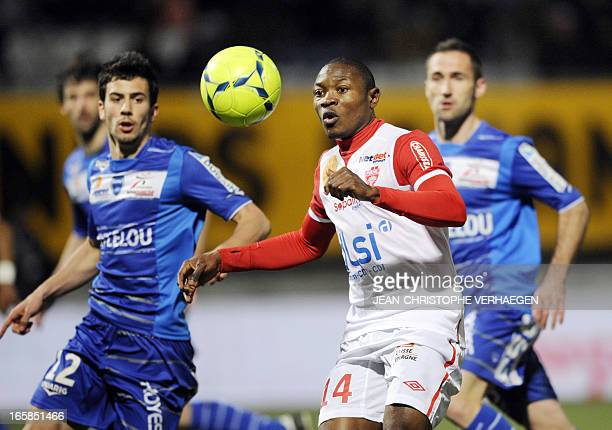 Nancy's Cameroonian forward Paul Alo'o Efoulou fights for the ball with Troyes' French midfielder Fabien Camus during their French L1 football match...