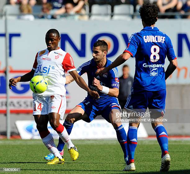 Nancy's Cameroonian forward Paul Alo'o Efoulou fights for the ball with Lyon's French midfielder Maxime Gonalons during their French L1 football...