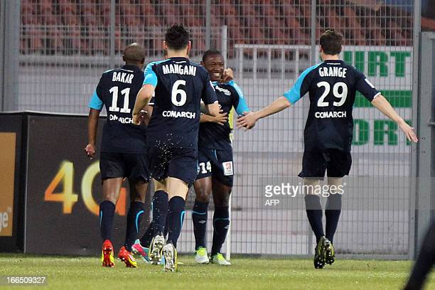 Nancy's Cameroonian forward Paul Alo'o Efoulou is congratulated by teammates after scoring during the French L1 football match Ajaccio vs Nancy at...