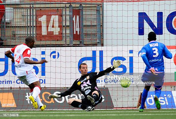 Nancy's Cameroonian forward Paul Alo'o Efoulou scores against Evian's French goalkeeper Bertrand Laquait during the French L1 football match Nancy vs...