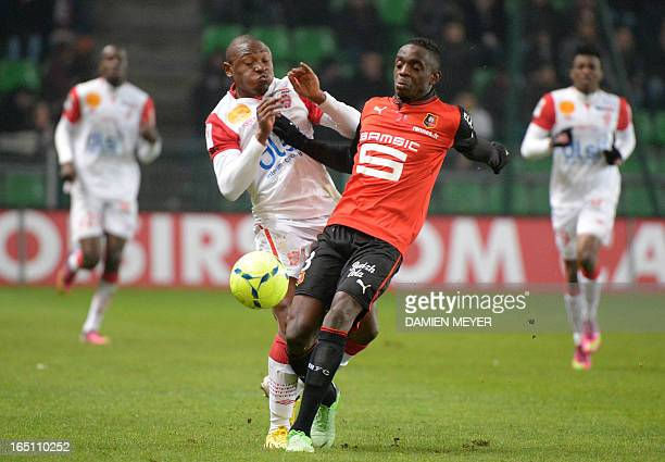 Nancy's Cameroonian forward Paul Alo'o Efoulou vies for the ball with Rennes' French defender Chris Mavinga during the French L1 football match...