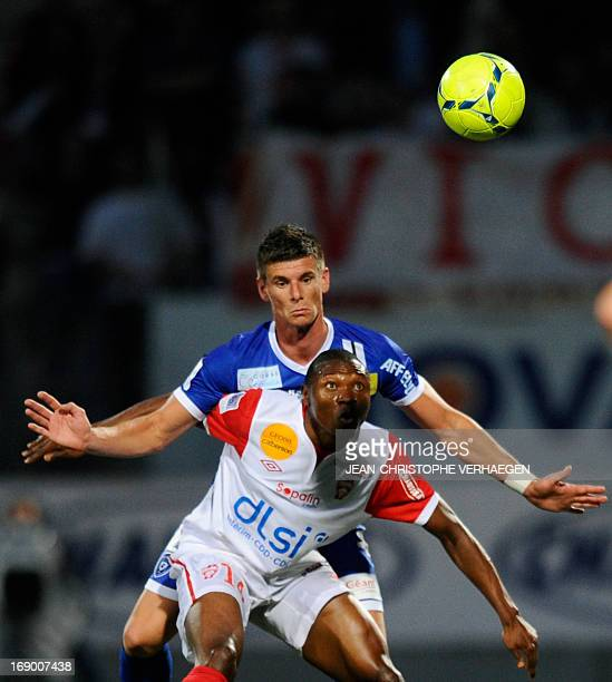 Nancy's Cameroonian forward Paul Alo'o Efoulou vies for the ball with Bastia's French defender Jeremy Choplin during the French L1 football match...