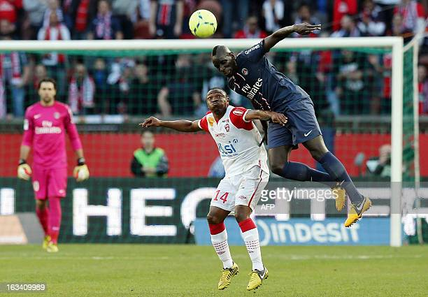 Nancy's Cameroonian forward Paul Alo'o Efoulou vies with Paris SaintGermain's French defender Mamadou Sakho during the French L1 football match Paris...