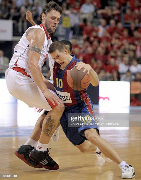 Nancy's Cyril Julian vies with Barcelona's Jaka Lakovic during their Euroleague group B basketball match in Nancy on October 23 2008 AFP PHOTO /...