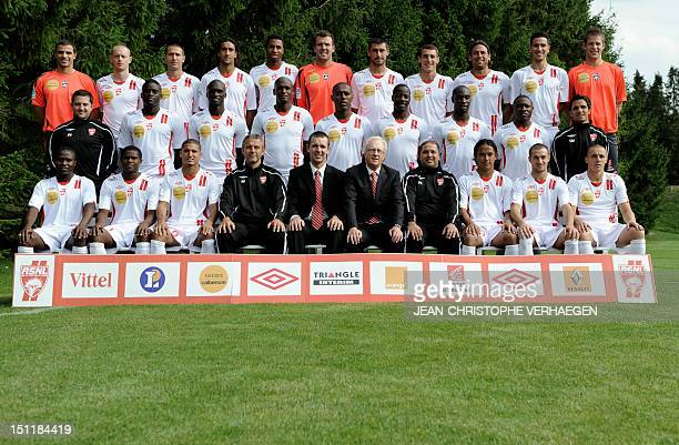 Nancy's football club players and staff pose for the 2010/2011 season team's official picture on August 6 2010 in VelaineenHaye eastern France Landry...