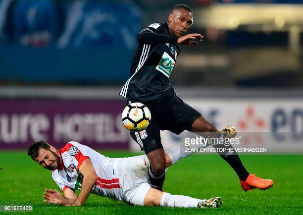 Nancy's French midfielder Antony Robic vies with Lyon's Brazilian defender Marcelo during the French Cup football match between Nancy and Lyon on...