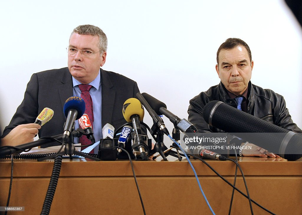 Nancy's French Prosecutor Thomas Pison (L) and Nancy's Director of Regional judiciary police Alain Couic (R) gives a press conference on December 19, 2012, in Nancy, eastern France, a day after a young woman kidnapped a new born baby in the regional maternity in Nancy. The woman introduced herself as a medical assistant and took the baby as the mother was sleeping. An alert had been launched by police on December 19.