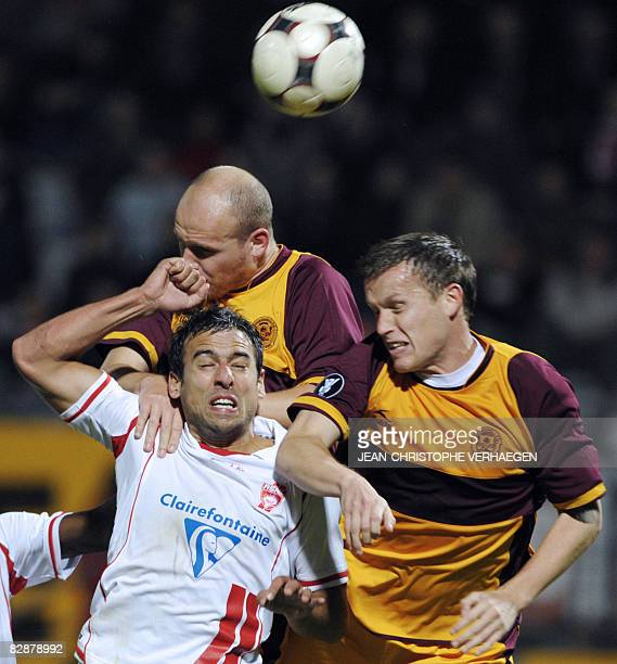 Nancy's Pascal Berenguer fights for the ball with Motherwell's Steven Hammel and Robert Malcolm during the UEFA CUP first round football match Nancy...