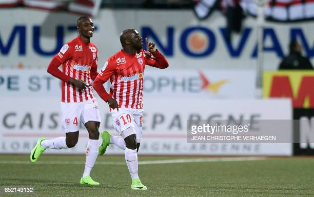 Nancy's Senegalese forward Issiar Dia celebrates after scoring during the French L1 football match between Nancy and Lille on March 11 2017 at Marcel...