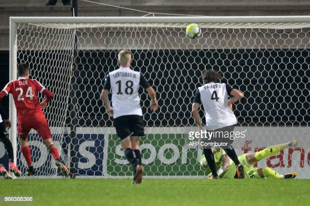 Nancy's Slovene forward Patrik Eler scores in spite of Angers' French goalkeeper Alexandre Letellier during the French League Cup football match...