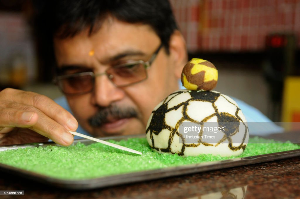 Nandalal's Sweet, a sweet maker prepares a football made with sweets to celebrate FIFA World Cup Football Tournament at the shop at Sukhia street, on June 14, 2018 in North Kolkata, India.