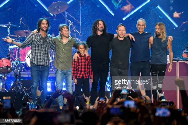 Nandi Bushell poses with Rami Jaffee, Chris Shiflett, Dave Grohl, Nate Mendel,Pat Smear, and Taylor Hawkins of Foo Fighters onstage at The Forum on...