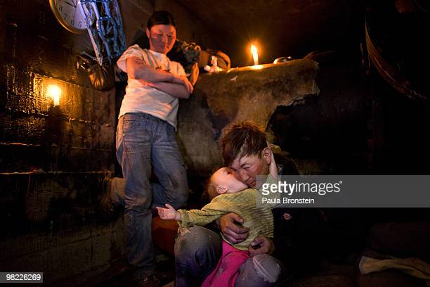 Nandintsetseg and father, Baigalnaa spend time with their son Munkhorgil, 18 months, before going to work, living inside the small sewer that the...