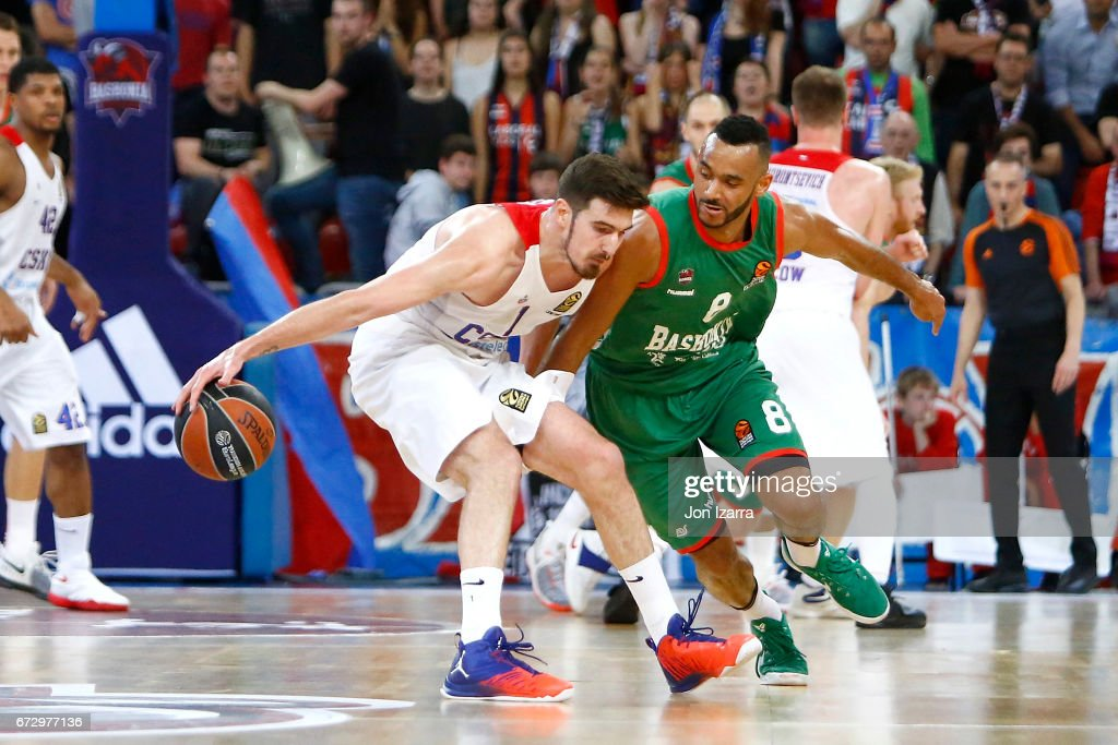 Nando de Colo, #1 of CSKA Moscow competes with Adam Hanga, #8 of Baskonia Vitoria Gasteiz during the 2016/2017 Turkish Airlines EuroLeague Playoffs leg 3 game between Baskonia Vitoria Gasteiz v CSKA Moscow at Fernando Buesa Arena on April 25, 2017 in Vitoria-Gasteiz, Spain.