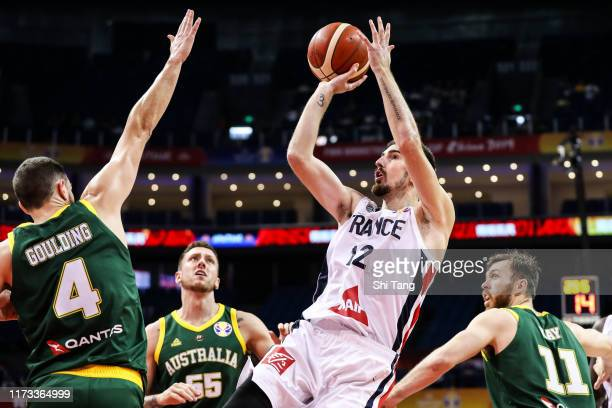 Nando De Colo of France shoots against Chris Goulding of Australia during 2nd round Group L match between Australia and France of 2019 FIBA World Cup...