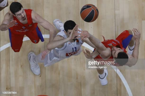 Nando De Colo and Alec Peters of CSKA Moscow vies with Goga Bitadze of Buducnost during the Turkish Airlines Euroleague match between CSKA Moscow and...