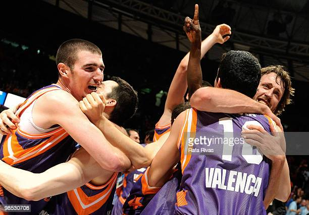 Nando De Colo and Matt Nielsen of Power Electronics Valencia celebrate their victory against Alba Berlin with teammates during the Champion Award...