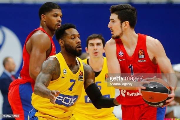 Nando De Colo of CSKA Moscow vies with DeAndre Kane of Maccabi Fox during the Turkish Airlines Euroleague match between CSKA Moscow and Maccabi Fox...