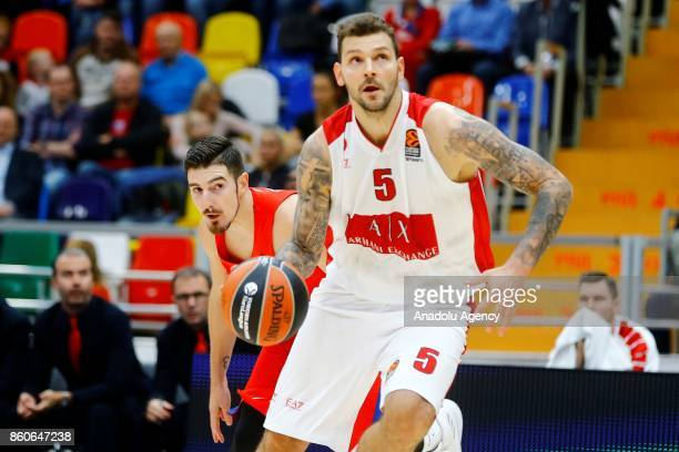Nando De Colo of CSKA Moscow vies with Vladimir Micov of AX Olimpia Milan during the Turkish Airlines Euroleague match between CSKA Moscow and AX...