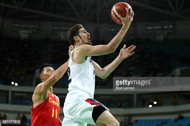 Nando de Colo of France shoots the ball over Jianlian Yi of China in the men's preliminary round group A game 19 on Day 3 of the Rio 2016 Olympic...