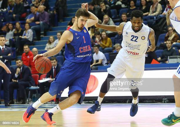 Nando De Colo of the CSKA Moscow drives to the basket against Antonio Graves of the Tsmoki Minsk during the game between CSKA Moscow v Tsmoki Minsk...