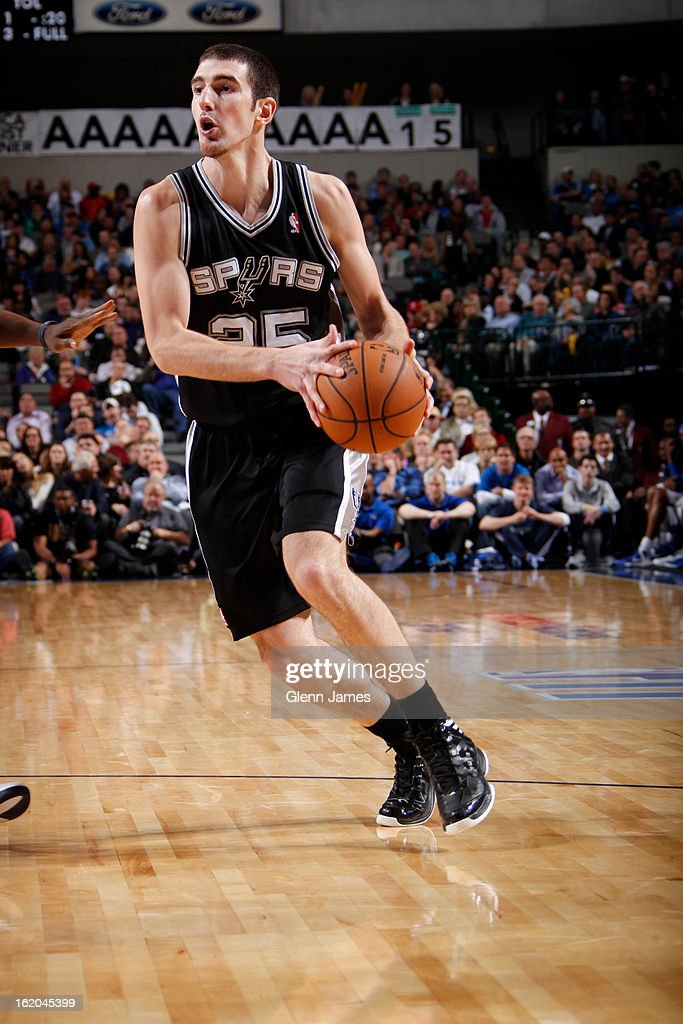 Nando de Colo #25 of the San Antonio Spurs drives to the basket against the Dallas Mavericks on January 25, 2013 at the American Airlines Center in Dallas, Texas.