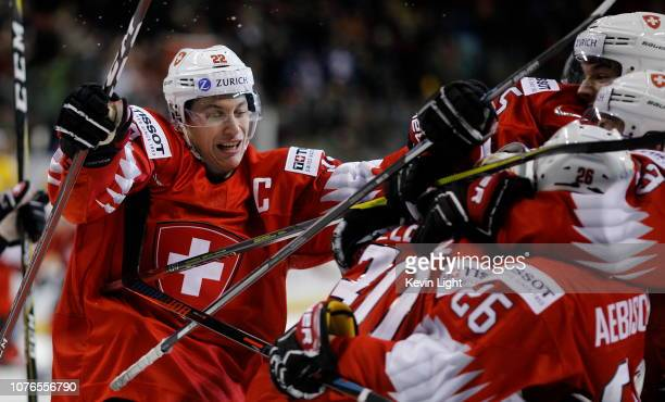 Nando Eggenberger of Switzerland celebrates following a 2-0 win over Sweden following a quarter-final game at the IIHF World Junior Championships at...