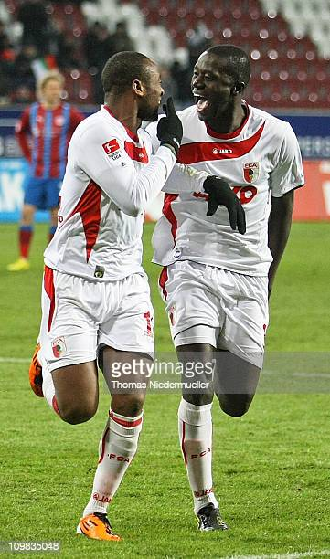 Nando Rafael celebrates his goal with Gibril Sabkoh of Augsburg during the second Bundesliga match between FC Augsburg and Fortuna Duesseldorf at the...