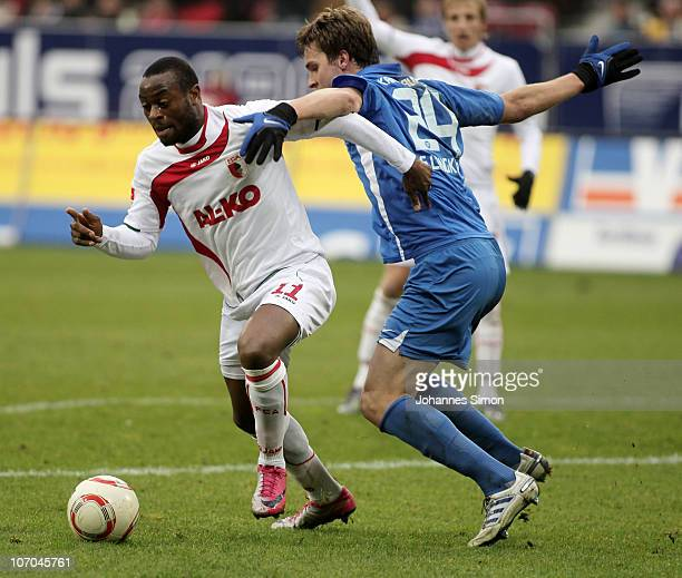 Nando Rafael of Augsburg and Sebastian Langkamp of Karlsruhe fight for the ball during the Second Bundesliga match between FC Augsburg v Karlsruher...