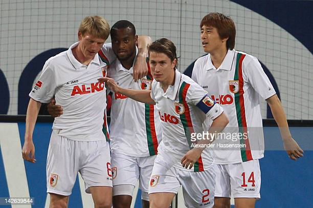Nando Rafael of Augsburg celebrates scoring the opening goal with with his team mates during the Bundesliga match between FC Augsburg and VfB...