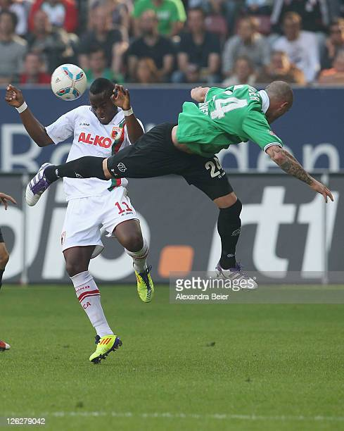 Nando Rafael of Augsburg fights for the ball with Christian Pander of Hannover during the Bundesliga match between FC Augsburg and Hannover 96 at SGL...