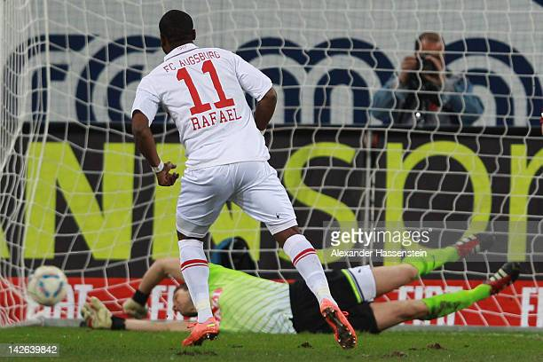 Nando Rafael of Augsburg score the opening goal with a penalty kick against Sven Ulreich, keeper of Stuttgart during the Bundesliga match between FC...