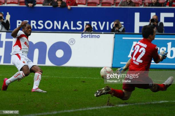 Nando Rafael of Augsburg scores his teams third goal against Dennis Eilhoff of Bielefeld during the Second Bundesliga match between FC Augsburg and...