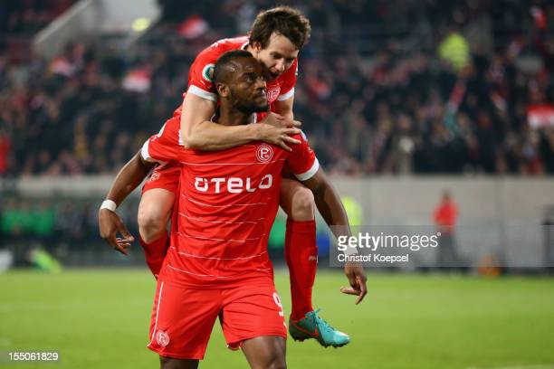 Nando Rafael of Duesseldorf celebrates the first goal with Robbie Kruse during the DFB Cup second round match between Fortuna Duesseldorf and...