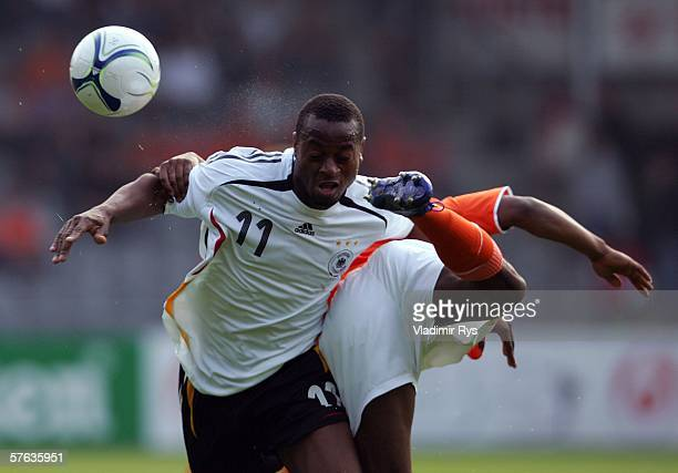Nando Rafael of Germany and Edson Braafheid of Netherlands battle for the ball during the Men's Under 21 international friendly match between...