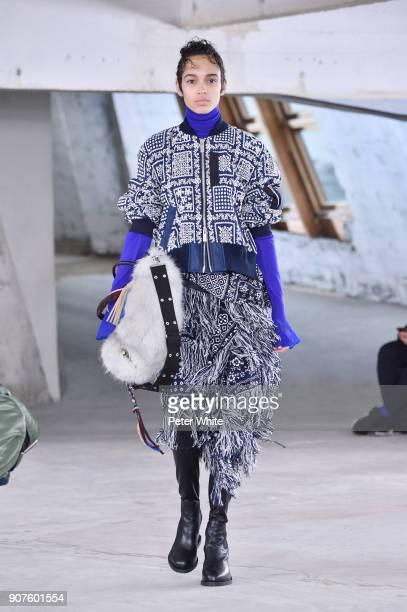 Nandy Nicodeme walks the runway during the Sacai Menswear Fall/Winter 20182019 show as part of Paris Fashion Week on January 20 2018 in Paris France