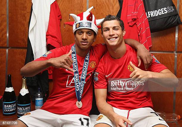 Nani and Cristiano Ronaldo of Manchester United celebrate in the dressing room after the Barclays Premier League match between Manchester United and...