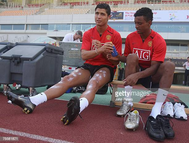 Nani and Cristiano Ronaldo of Manchester United in action during a First Team training session at Macau Stadium on July 21 2007 in Macau China