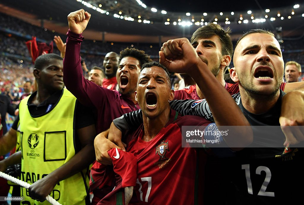 Nani (C) and Portugal players celebrate after their team's 1-0 win against France in the UEFA EURO 2016 Final match between Portugal and France at Stade de France on July 10, 2016 in Paris, France.