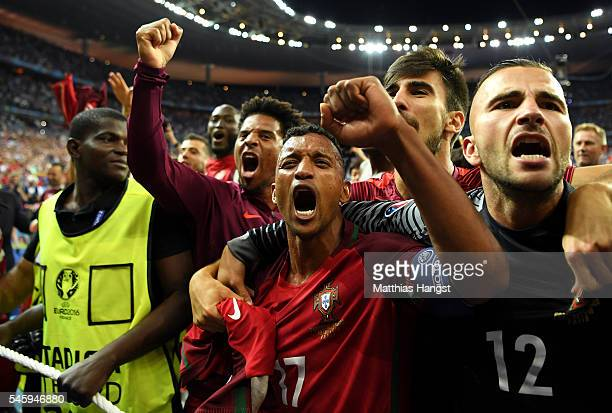 Nani and Portugal players celebrate after their team's 1-0 win against France in the UEFA EURO 2016 Final match between Portugal and France at Stade...