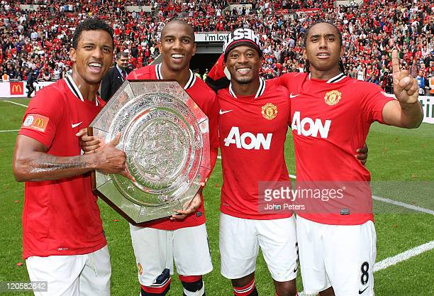 Nani Ashley Young Patrice Evra and Anderson of Manchester United pose with the Community Shield trophy after the FA Community Shield match between...