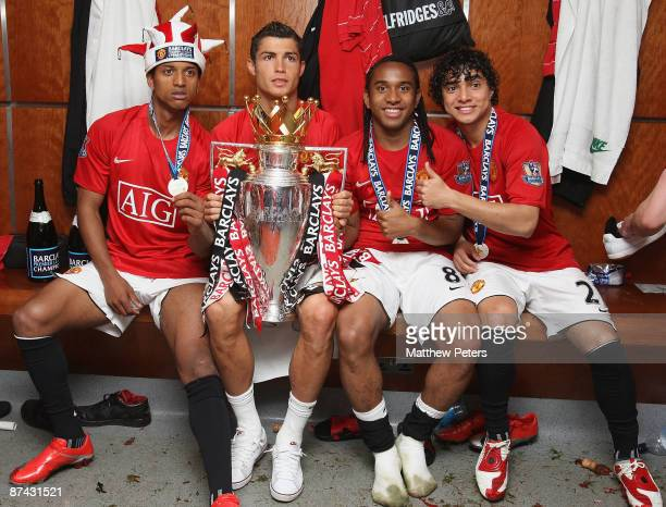 Nani Cristiano Ronaldo Anderson and Rafael Da Silva of Manchester United celebrate with the Premier League Trophy in the dressing room after the...
