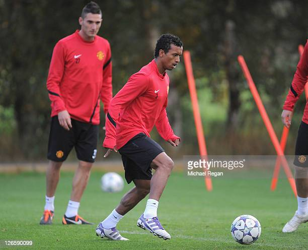 Nani in action watched by Federico Macheda during a Manchester United training session ahead of their UEFA Champions League Group C match against...
