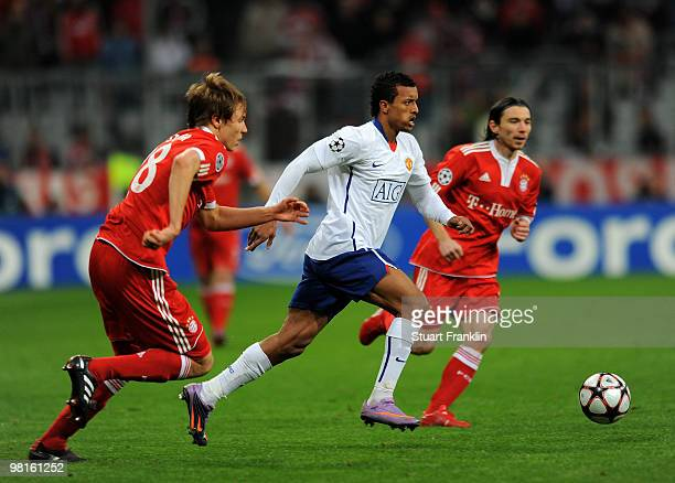 Nani of Manchester is challenged by Holger Badstuber of Bayern during the UEFA Champions League quarter final first leg match between FC Bayern...